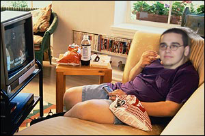 OVERWEIGHT CHILD, BOY, WATCHING TELEVISION, OBESE, FAT.